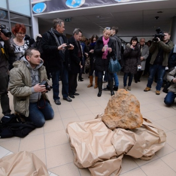 Journalists take pictures of Eastern Europe's largest meteorite, weighing about 300kg, in Poznan, western Poland. Credit: JAKUB KACZMARCZYK / PAP / AFP