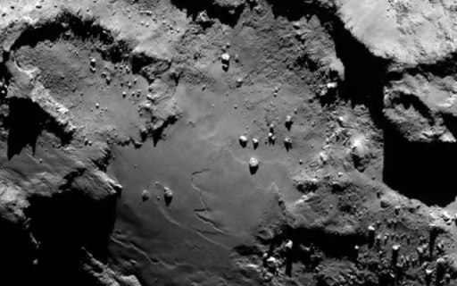 Close up detail focusing on a smooth region on the 'base' of the 'body' section of comet 67P/Churyumov-Gerasimenko. (Photo Credit: ESA/Rosetta/MPS for OSIRIS Team)